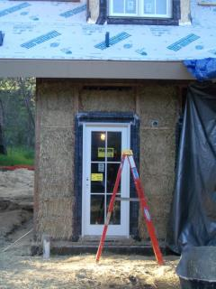 [Exterior straw bale wall before wire mesh]