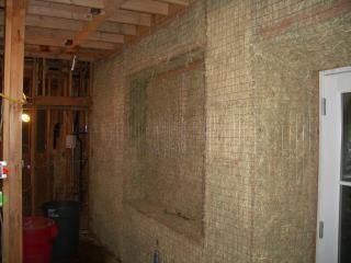 [Master bedroom straw bale wall before plaster]