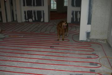 [Radiant heat tubes on first floor before slab poured]
