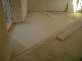 [First floor limestone tiling started]